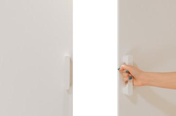 Women hand open door with copy space behind the door.