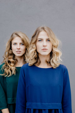 Portrait of young female twins