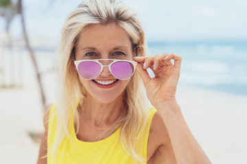 Stylish blond woman with trendy sunglasses