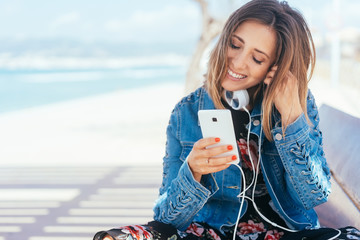 Relaxed happy young woman listening to her music