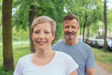 Mature couple enjoying a walk through a park