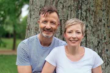 Portrait of a happy middle-age couple in the park