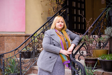 Concept of life modern woman in big city, lifestyle citizen peoples, lady at spring or autumn day. Middle age woman plus size , walk around center streets