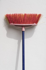 a broom leaning against the wall