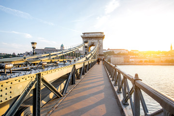 Beautiful cityscape view on the famous Chain bridge on Danube river during the sunset in Budapest city, Hungary