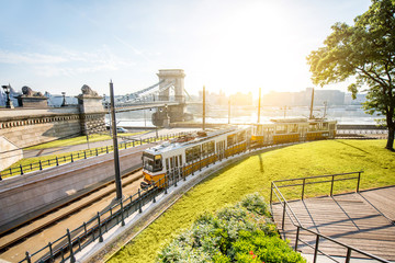 Cityscape view on the tram and famous Chain bridge on the background during the morning light in Budapest city, Hungary