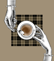 Woman's hands with a coffee cup and spoon