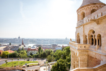 View on the wall of Fiserman's bastion with woman standing on the terrace enjoying the view on Budapest city in Hungary