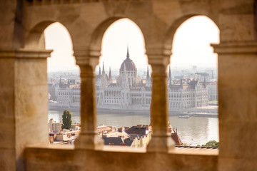 View on the Parliament building through the balustrade of Fisherman's bastion in Budapest, Hungary