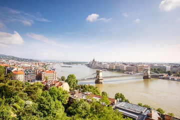 Panoramic view on Budapest city with Chain bridge and famous Parliament building during the morning light in Hungary