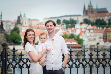 Beautiful family with little boy visiting Prague