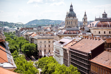 Top view on Andrassy avenue with saint Stephen cathedral during the daylight in Budapest city, Hungary