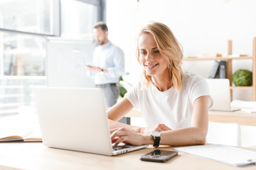 Attractive woman manager working on laptop computer