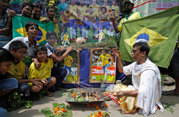 "Soccer fans perform ""havan"" (traditional Hindu fire ritual) as part of a special prayer for the better performance and win for Brazil in the FIFA World Cup 2018 in Russia, at Howrah"