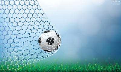Soccer football ball in soccer goal and net with light blurred bokeh background and green grass field. Vector illustration.