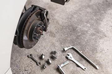 mechanic changing a wheel  car