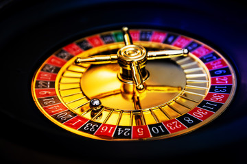 Casino playing roulette on green table