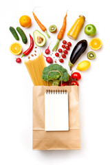 Image of paper bag with vegetables, fruits and spaghetti