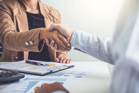 Business partnership meeting concept, Two confident Business handshake and business people after discussing good deal of Trading contract and new projects for both companies, success, partnership