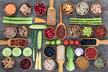 Healthy super food for fitness concept with legumes,fresh vegetables and fruit, & spices. High in omega 3 fatty acids, antioxidants, anthocyanins, vitamins & minerals.