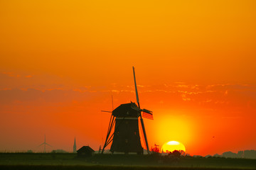 Dutch windmill during sunrise