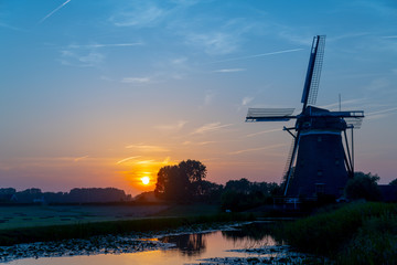 Windmill during sunset at the Dutch polder