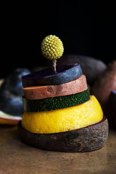 Tower of food's slices on a handmade clay plate. .