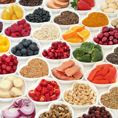 Healthy food nutrition for good health with fresh fruit, vegetables, fish, cereals, seeds, herbs and herbal medicine. Super food concept with foods high in omega 3 protein, antioxidants & fibre.