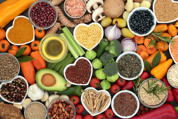 Foto auf Leinwand Sortiment Food for good health and fitness concept with fruit, vegetables, pulses, grains, herbs, spices, nuts, seeds, olive oil & himalayan salt. High in antioxidants, smart carbohydrates & anthocyanins.