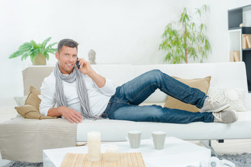 Man on the phone on a couch