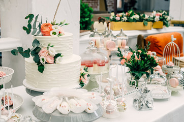 Two-tier cake on a sweets table at a wedding