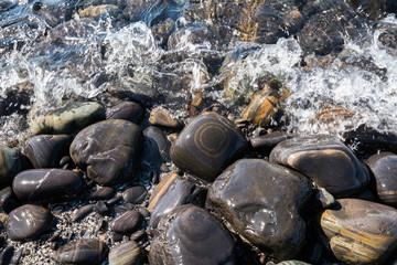 Small beautiful pebble stone around the beach