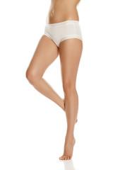 pretty feminine legs and white panties on white background
