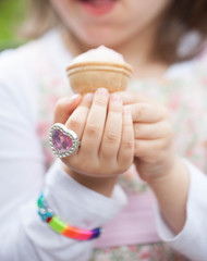 delicious natural red ice cream in hand palm, child. plastic ring differs heart..
