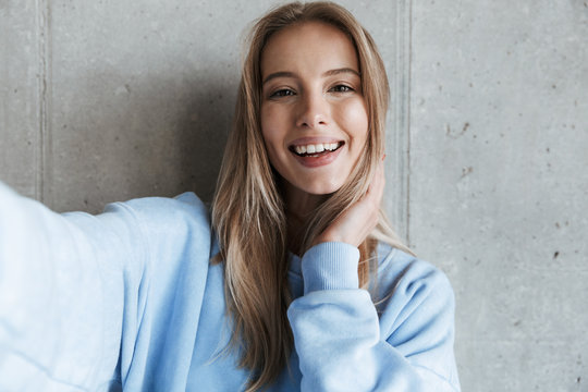 Happy pretty woman make selfie by camera.