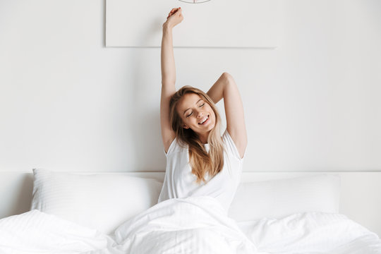 Beautiful pretty woman lies on bed