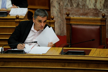 Greek Parliament votes on reforms agreed with the country's international lenders in Athens