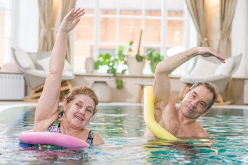 Elderly people are engaged in fitness in the pool