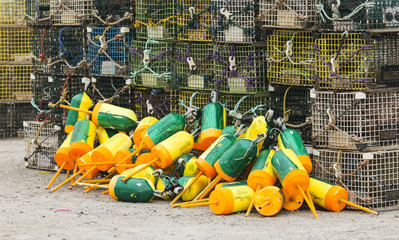 Lobster traps and buoys stacked high