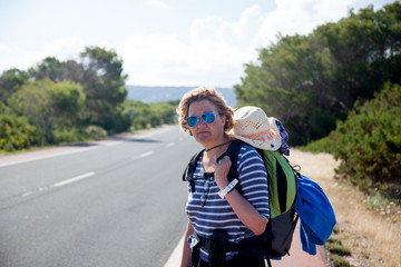 Travelling woman hitchhiking