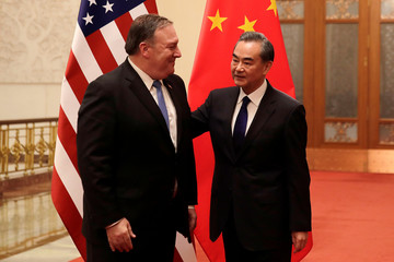 U.S. Secretary of State Mike Pompeo chats with Chinese Foreign Minister Wang Yi before their meeting at the Great Hall of the People in Beijing
