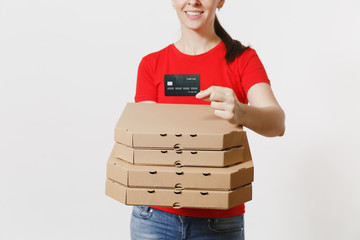 Delivery woman in red cap, t-shirt giving food order italian pizza in cardboard flatbox boxes isolated on white background. Female pizzaman working as courier holding credit card. Cropped photo.