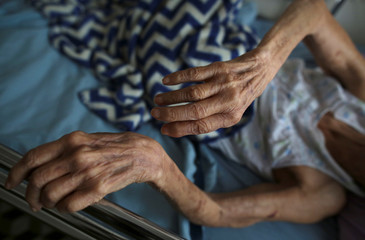 The arms of an elderly woman are seen at the San Rafael nursing home in Arecibo