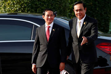 Thailand's Prime Minister Prayuth Chan-o-cha welcomes Myanmar's President Win Myint at the Government House in Bangkok