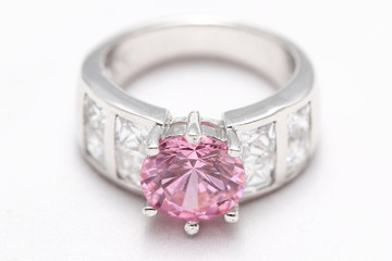 pink gem stone on diamond ring