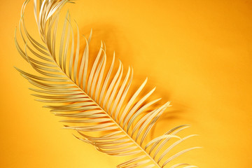 Tropical yellow background with golden leaves