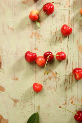 Fresh Cherries on a rustic table