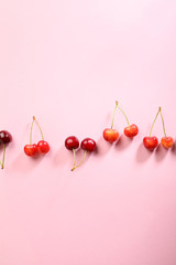 cherries on pink background
