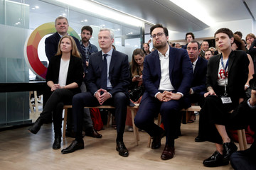 Mounir Mahjoubi, French Junior Minister in Charge of Digital Sector, and French Finance Minister Bruno Le Maire attend a visit of the new Qwant headquarters in Paris