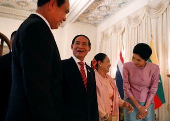 Thailand's Prime Minister Prayut Chan-o-cha and Myanmar's president Win Myint chat before their meeting in the Government House at Bangkok